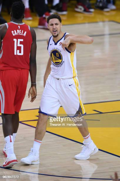 Klay Thompson of the Golden State Warriors reacts after making a threepoint basket against the Houston Rockets during Game Six of the Western...