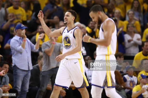 Klay Thompson of the Golden State Warriors reacts after scoring against the Houston Rockets during Game Six of the Western Conference Finals in the...
