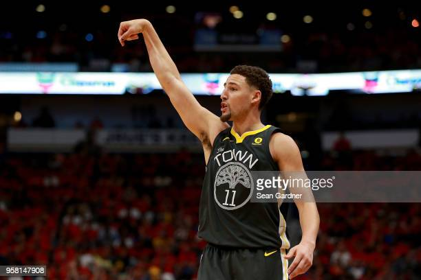 Klay Thompson of the Golden State Warriors reacts after shooting a three pointer against the New Orleans Pelicans during Game Four of the Western...
