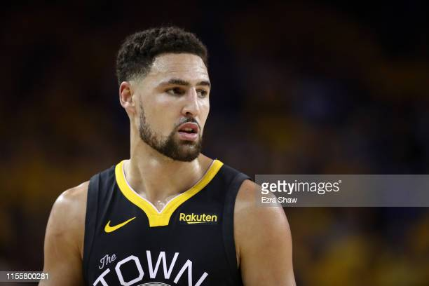 Klay Thompson of the Golden State Warriors reacts against the Toronto Raptors in the first half during Game Six of the 2019 NBA Finals at ORACLE...