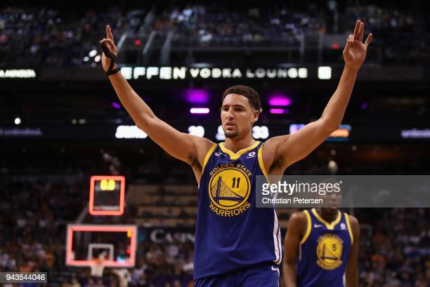 Klay Thompson of the Golden State Warriors reacts during the first half of the NBA game against the Phoenix Suns at Talking Stick Resort Arena on...