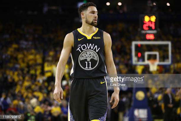 Klay Thompson of the Golden State Warriors reacts in the first half against the Toronto Raptors during Game Six of the 2019 NBA Finals at ORACLE...