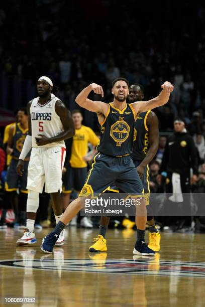 Klay Thompson of the Golden State Warriors reacts to making a jump shot as Montrezl Harrell of the Los Angeles Clippers looks on on November 12 2018...