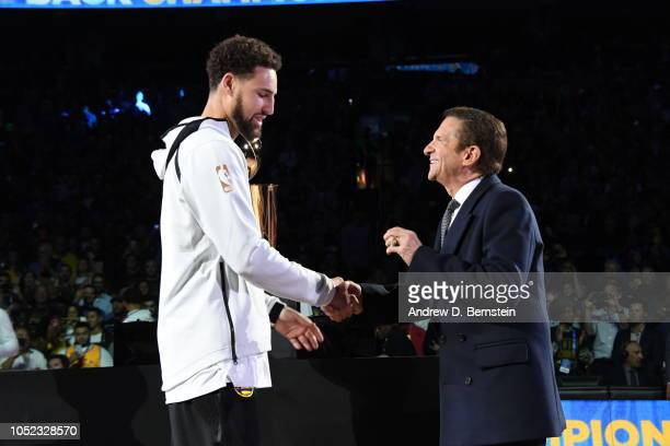 Klay Thompson of the Golden State Warriors receives his 2018 NBA finals Championship ring from Owner Peter Guber on October 16 2018 at ORACLE Arena...