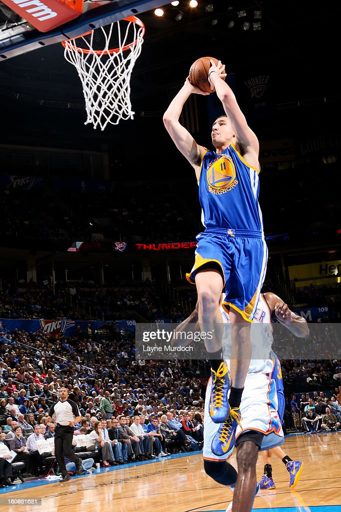 Klay Thompson #11 of the Golden State Warriors rises for a dunk against the Oklahoma City Thunder on February 6, 2013 at the Chesapeake Energy Arena in Oklahoma City, Oklahoma.