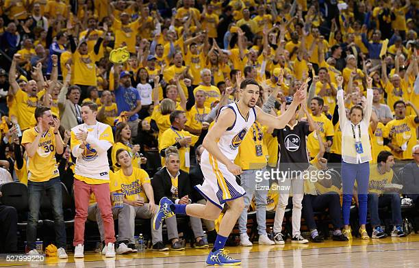 Klay Thompson of the Golden State Warriors runs back down court after making a threepoint basket against the Portland Trail Blazers during Game Two...