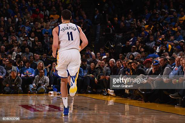 Klay Thompson of the Golden State Warriors runs up court during the game against the Indiana Pacers on December 5 2016 at ORACLE Arena in Oakland...