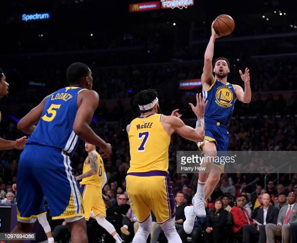 Klay Thompson of the Golden State Warriors scores on a layup in front of JaVale McGee of the Los Angeles Lakers during the first half at Staples...