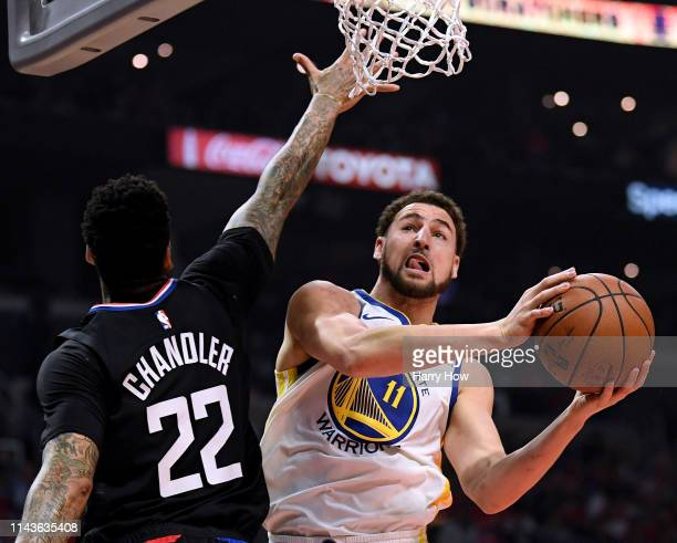 Klay Thompson of the Golden State Warriors scores on a layup past Wilson Chandler of the LA Clippers during Game Two of Round One of the 2019 NBA...