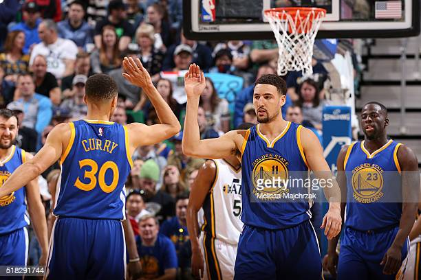 Klay Thompson of the Golden State Warriors shakes hands with Stephen Curry of the Golden State Warriors during the game against the Utah Jazz on...