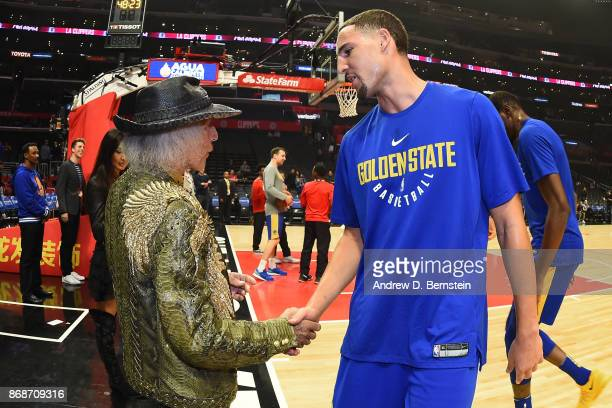 Klay Thompson of the Golden State Warriors shakes hands with Superfan James Goldstein before the game on October 30 2017 at STAPLES Center in Los...