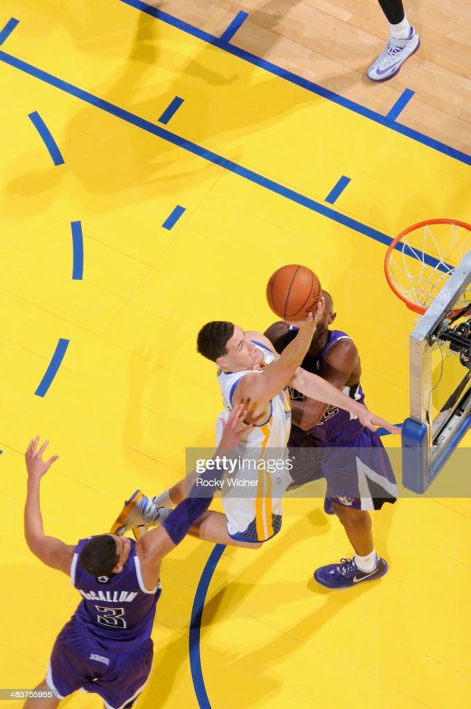 Klay Thompson #11 of the Golden State Warriors shoots a layup against Ray McCallum #3 of the Sacramento Kings on April 4, 2014 at Oracle Arena in Oakland, California.