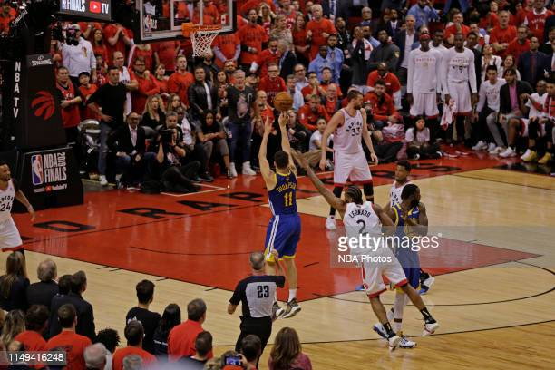 Klay Thompson of the Golden State Warriors shoots a three point basket against the ball against the Toronto Raptors during Game Five of the NBA...