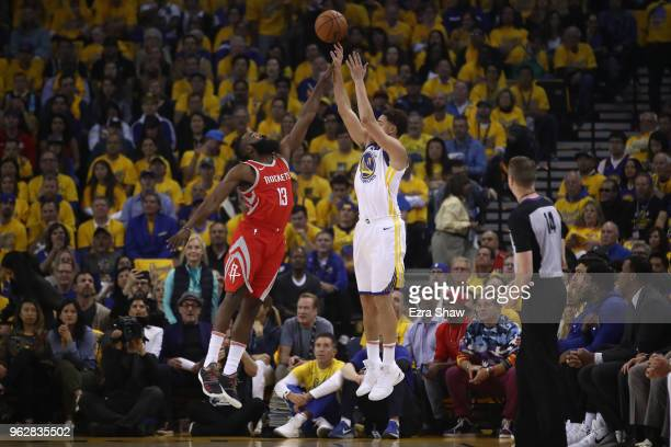 Klay Thompson of the Golden State Warriors shoots a threepoint attempt as James Harden of the Houston Rockets defends during Game Six of the Western...