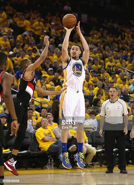 Klay Thompson of the Golden State Warriors shoots a threepoint basket against the Portland Trail Blazers during Game One of the Western Conference...