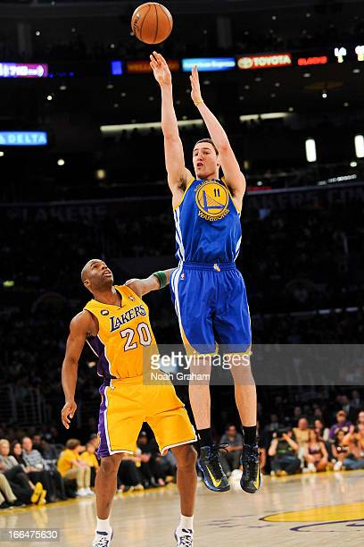 Klay Thompson of the Golden State Warriors shoots a threepointer against Jodie Meeks of the Los Angeles Lakers at Staples Center on April 12 2013 in...