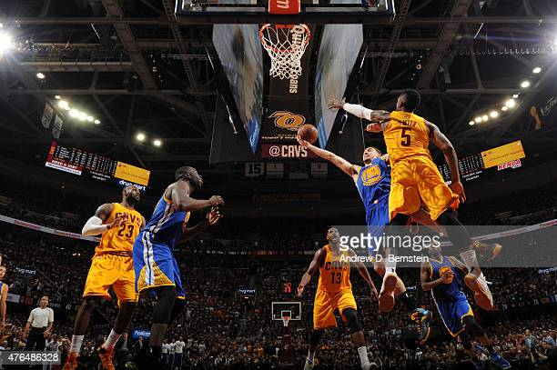Klay Thompson of the Golden State Warriors shoots against JR Smith of the Cleveland Cavaliers during Game Three of the 2015 NBA Finals at The Quicken...