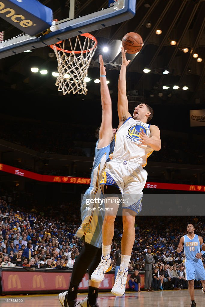 Klay Thompson #11 of the Golden State Warriors shoots against the Denver Nuggets on January 19, 2015 at Oracle Arena in Oakland, California.