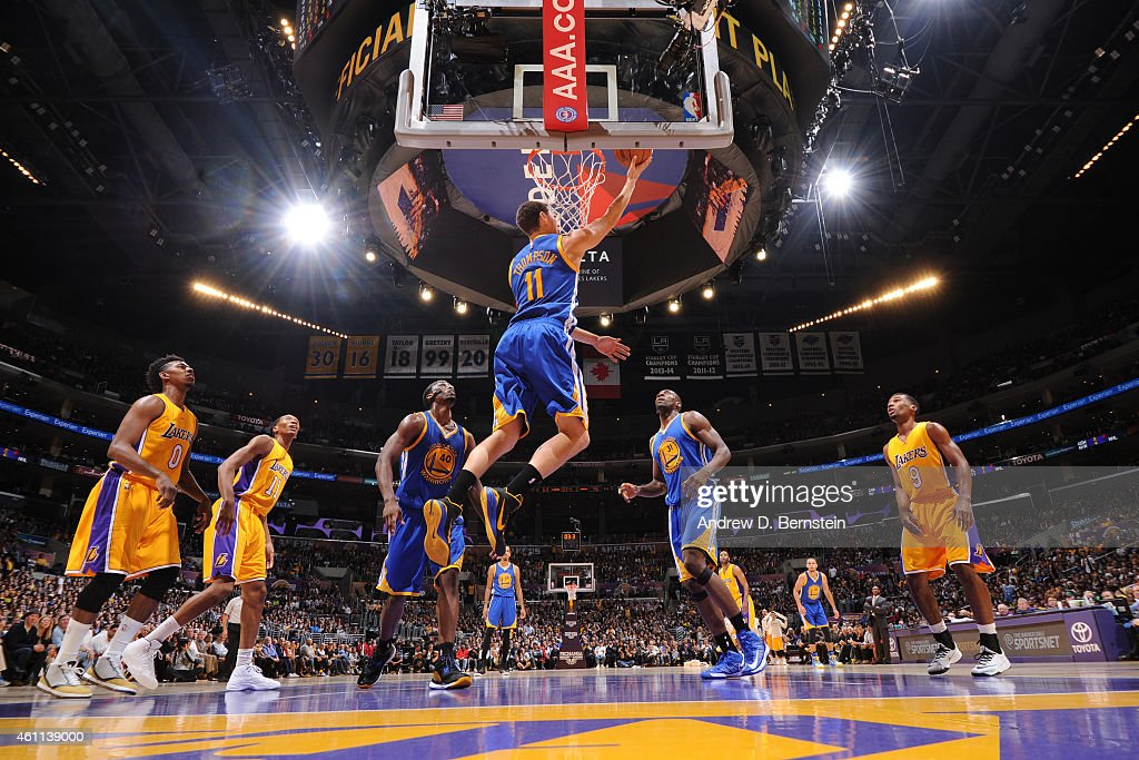Klay Thompson #11 of the Golden State Warriors shoots against the Los Angeles Lakers on December 23, 2014 at Staples Center in Los Angeles, California.
