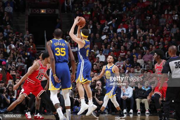 Klay Thompson of the Golden State Warriors shoots his 14th three pointer to break the single game record for the most three's against the Chicago...