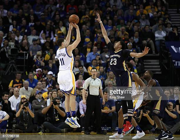 Klay Thompson of the Golden State Warriors shoots over Anthony Davis of the New Orleans Pelicans at ORACLE Arena on March 14 2016 in Oakland...