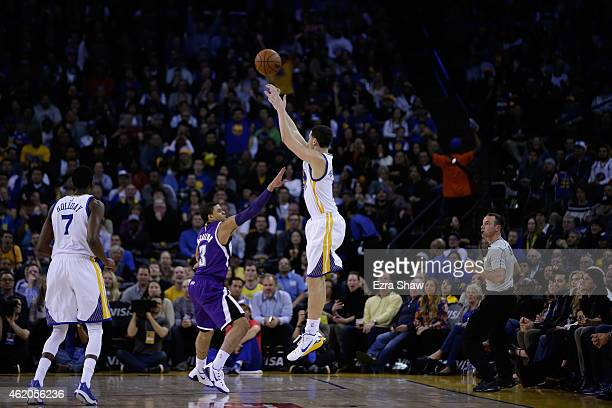 Klay Thompson of the Golden State Warriors shoots over Ray McCallum of the Sacramento Kings in the third quarter at ORACLE Arena on January 23, 2015...