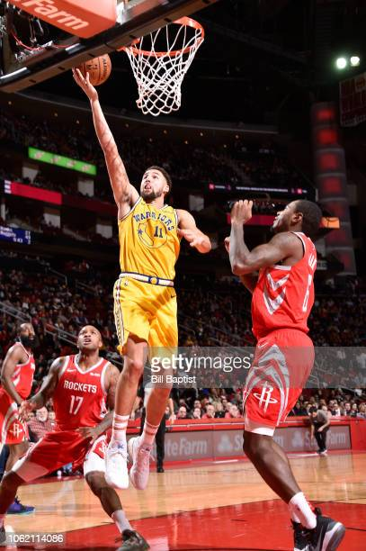 Klay Thompson of the Golden State Warriors shoots the ball against the Houston Rockets on November 15 2018 at the Toyota Center in Houston Texas NOTE...