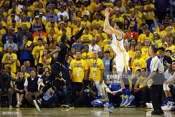 Klay Thompson of the Golden State Warriors shoots the ball against Kyrie Irving of the Cleveland Cavaliers during the first half in Game 7 of the...