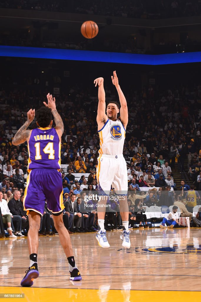 Klay Thompson #11 of the Golden State Warriors shoots the ball against the Los Angeles Lakers on April 12, 2017 at ORACLE Arena in Oakland, California.
