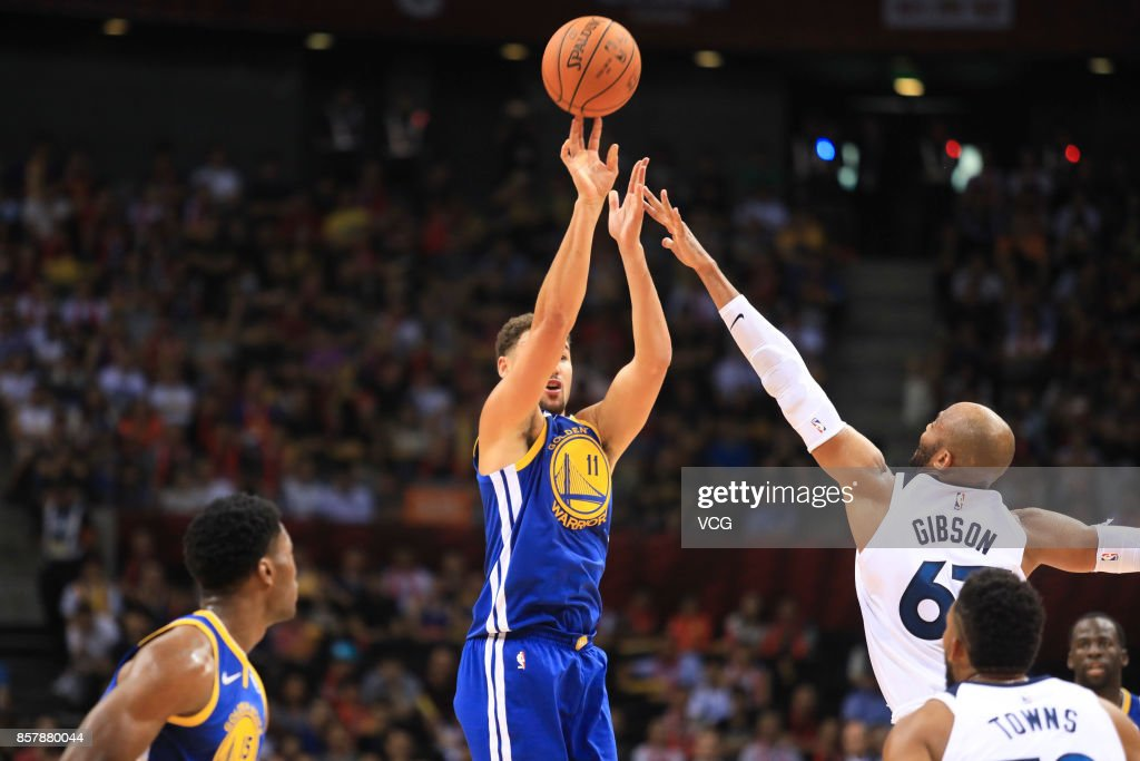 Klay Thompson #11 of the Golden State Warriors shoots the ball against Taj Gibson #67 of the Minnesota Timberwolves during the game between the Minnesota Timberwolves and the Golden State Warriors as part of 2017 NBA Global Games China at Shenzhen Universidade on October 5, 2017 in Shenzhen, China.
