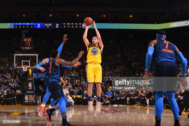 Klay Thompson of the Golden State Warriors shoots the ball against the Oklahoma City Thunder on February 24 2018 at ORACLE Arena in Oakland...
