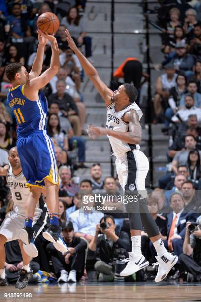 Klay Thompson of the Golden State Warriors shoots the ball over Rudy Gay of the San Antonio Spurs during Game Three of the Western Conference...