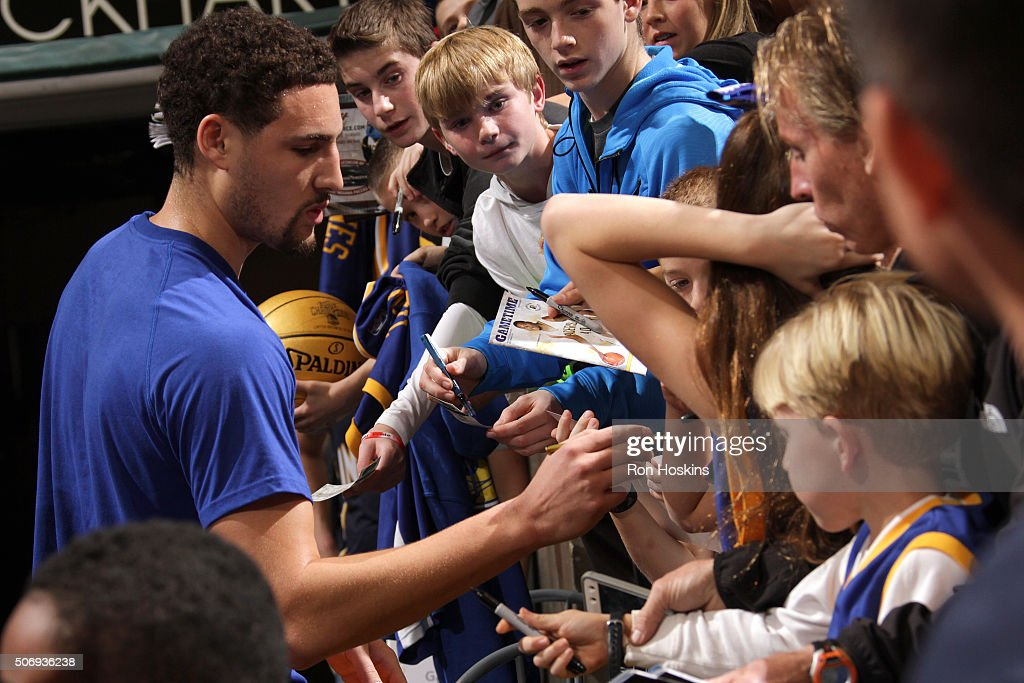 Klay Thompson #11 of the Golden State Warriors signs autographs before the game against the Indiana Pacers on December 8, 2015 at Bankers Life Fieldhouse in Indianapolis, Indiana.