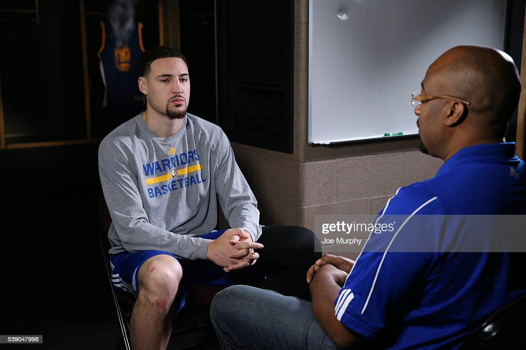 Klay Thompson #11 of the Golden State Warriors sits down with an interview with Dennis Scott during practice and media availability as part of the 2016 NBA Finals on June 9, 2016 at Quicken Loans Arena in Cleveland, Ohio.