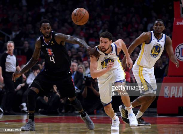 Klay Thompson of the Golden State Warriors steals the ball from JaMychal Green of the LA Clippers in the first half during Game Six of Round One of...