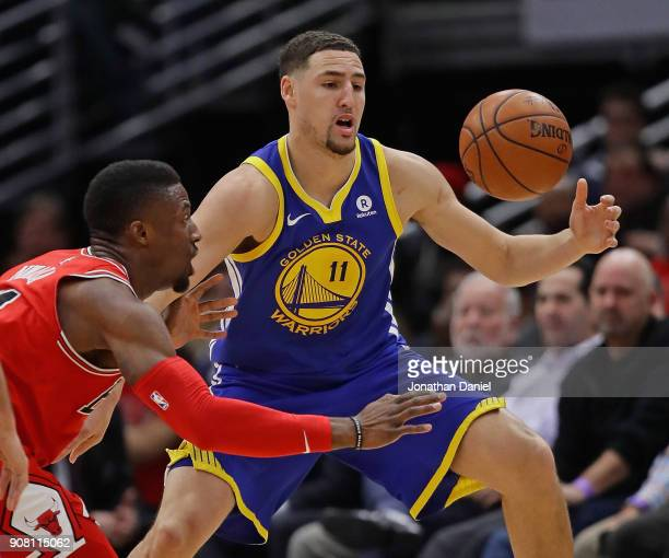 Klay Thompson of the Golden State Warriors takes a pass against David Nwaba of the Chicago Bulls at the United Center on January 17 2018 in Chicago...