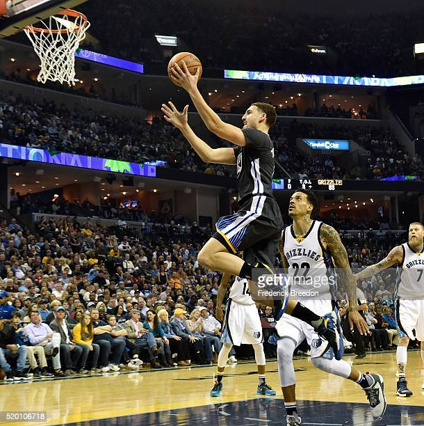 Klay Thompson of the Golden State Warriors takes a shot against of the Memphis Grizzlies during the second half at FedExForum on April 9, 2016 in...