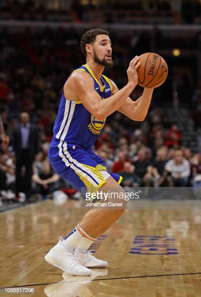 Klay Thompson of the Golden State Warriors takes aim on a three point shot on his way to a gamehigh 52 points against the Chicago Bulls at the United...