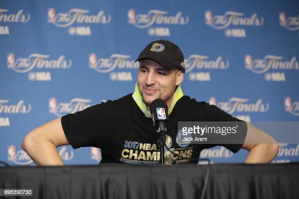 Klay Thompson of the Golden State Warriors talks to the media after winning the NBA Championship against the Golden State Warriors in Game Five of...