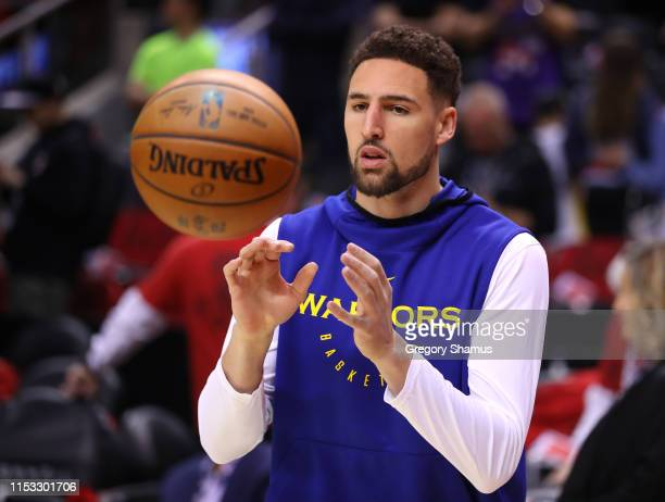 Klay Thompson of the Golden State Warriors warms up before Game Two of the 2019 NBA Finals against the Toronto Raptors at Scotiabank Arena on June...