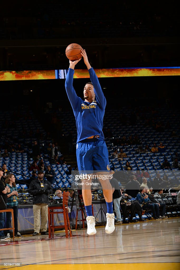 Klay Thompson #11 of the Golden State Warriors warms up before the game against the Milwaukee Bucks on December 18, 2015 at Oracle Arena in Oakland, California.