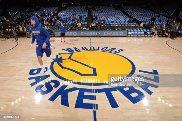 Klay Thompson of the Golden State Warriors warms up prior to the game against the Sacramento Kings on March 16 2018 at ORACLE Arena in Oakland...