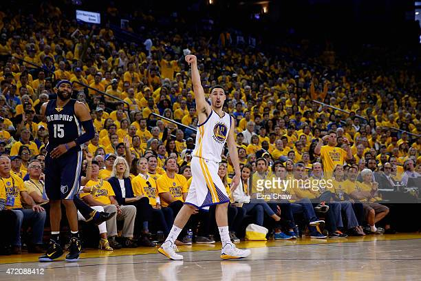 Klay Thompson of the Golden State Warriors watches a threepointer go through the basket against the Memphis Grizzlies during Game One of the Western...