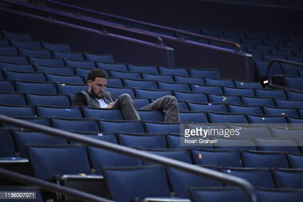 Klay Thompson of the Golden State Warriors watches from the stands the Golden State Warriors raise a banner for 47 incredible seasons at Oracle Arena...