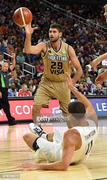 Klay Thompson of the United States falls down after being fouled by Patricio Garino of Argentina during a USA Basketball showcase exhibition game at...