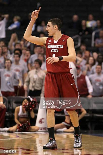 Klay Thompson of the Washington State Cougars reacts after making a shot in the second half while taking on the Washington Huskies in the...