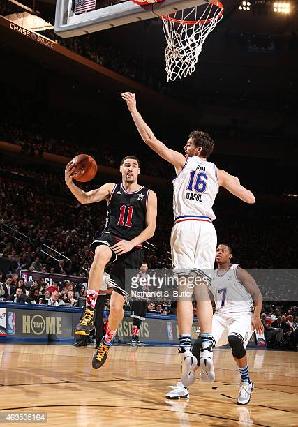 Klay Thompson of the Western Conference AllStar Team goes up to shoot against Pau Gasol of the Eastern Conference Team during the 64th NBA AllStar...