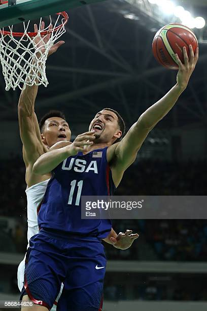 Klay Thompson of United States goes to the basket against Jianlian Yi of China in the Men's Preliminary Round Group A match on Day 1 of the Rio 2016...