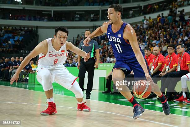 Klay Thompson of United States goes to the basket against Yanyuhang Ding of China in the Men's Preliminary Round Group A match on Day 1 of the Rio...