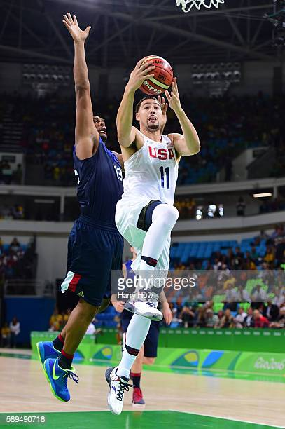 Klay Thompson of United States shoots past Boris Diaw of France during a Men's Preliminary Round Group A game between the United States and France on...